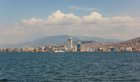Izmir view with ferry. View on Izmir downtown from Izmir bay with a passenger ferry Royalty Free Stock Image