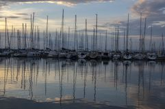 Izola / SLOVENIA - June 24, 2018: Marina with many boats against sunset. Picturesque summer scenery. Summer end of the day. Ships reflections stock photo