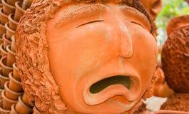 Izquierda triste de la loza de barro de la cara Fotos de archivo libres de regalías