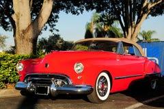 Izquierdo de frontal izquierda de lujo rojo del coche Imagen de archivo