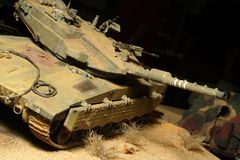 Izraeli Merkava tank. Modern izraeli Merkava tanks in night action - plastic model 1:32 scale - closeup Royalty Free Stock Photos