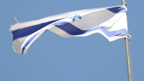 Izraelicki flagi państowowej falowanie w wiatrze przy górą oliwka w Jerozolima, Izrael zdjęcie wideo