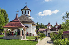 IZVOARELE, ROMANIA - AUGUST 31, 2014:People awaiti. View of interior yard of Crasna Monastery, beautiful old orthodox monastery in Izvoarele village, Prahova royalty free stock photos