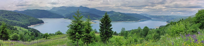 Summer landscape. Panorama of Izvorul Muntelui Lake, Romania. Summer landscape. Panorama of Izvorul Muntelui Lake (Mountain Spring Lake), Romania Stock Photo