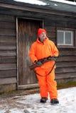 Jägare i ljus apelsin med kabinen Arkivfoto