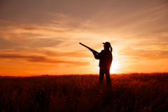 Jäger im Sonnenuntergang Stockbilder