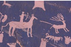 Jäger-Petroglyphe Lizenzfreies Stockfoto