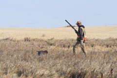 Jäger und sein Hund Stockfoto