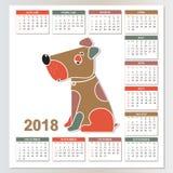 2018-jährig vom gelben Hund Wandkalender von Sonntag bis Samstag Lizenzfreies Stockfoto
