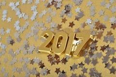 2017-jährige goldene Zahlen und Silbersterne Stockbild