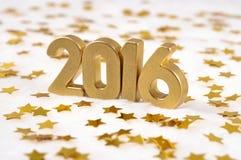 2016-jährige goldene Zahlen und von goldenen Sternen Lizenzfreies Stockfoto