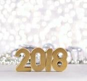 2018-jährige goldene Zahlen und Weihnachtsdekorationen Stockfoto