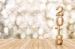 2016-jährige hölzerne Zahl im Perspektivenraum mit funkelndem bokeh w Lizenzfreie Stockfotografie