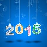 2015-jährige Zahl mit Blättern und blauem backround Schneiden Sie das Papier Lizenzfreie Stockbilder