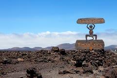 Jäkeltecken av den ingångsTimanfaya nationalparken i Lanzarote Fotografering för Bildbyråer