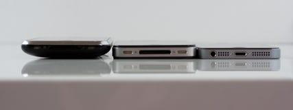 Jämförelse av iPhonen 3G-4-5S Arkivfoton