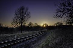 Järnväg i solnedgång Fotografering för Bildbyråer