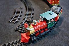 Järnväg leksakdrev och barn Fotografering för Bildbyråer