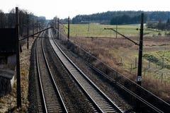 Järnväg linje för drev för snabb stång Järnväg linje och electr Royaltyfri Foto