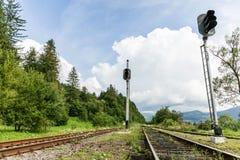 Järnväg resabakgrund, stångdrevlandskap arkivfoto