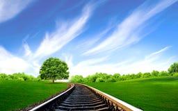 Järnvägen spårar nära treen Arkivbilder