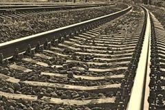 Järnvägspår in i sepia fotografering för bildbyråer