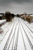 Järnvägsspår med snöfall Royaltyfria Bilder
