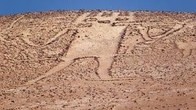 Jätte av Atacamaen, stor petroglyph på ett berg i Atacen Fotografering för Bildbyråer