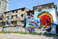 Jätte- grafitti på övergiven byggnad Royaltyfria Foton