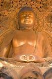 jätte- guld- tempel för buddha byodo Arkivfoto