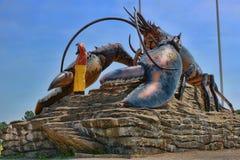 Jätte- hummerstatygränsmärke Arkivbilder