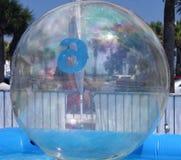 Jätte- uppblåsbar plast- boll eller bubbla royaltyfri foto
