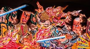 Jätte- upplyst Nebuta flöte i Nebuta Warasse, Aomori, Japan Royaltyfria Bilder