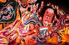 Jätte- upplyst Nebuta flöte i Nebuta Warasse, Aomori, Japan Royaltyfri Foto