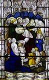 Jésus bénissant un enfant en verre souillé Photographie stock libre de droits