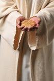 Jésus retenant un pain et un vin Photographie stock libre de droits