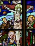 Jésus sur la croix - verre souillé Photographie stock libre de droits