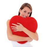 Jóvenes con la almohadilla en forma de corazón Foto de archivo libre de regalías