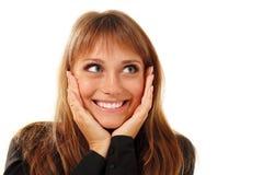 Jóvenes hermosos de la mujer que miran para arriba en la esquina Foto de archivo libre de regalías