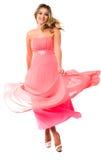 Jóvenes hermosos en vestido de fiesta que agita Imagen de archivo