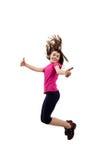 Jóvenes que saltan mostrando la muestra ACEPTABLE Foto de archivo libre de regalías
