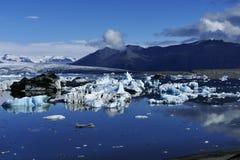 Jökulsárlón glacier lagoon in bright sunshine, reflecting icebergs, Iceland stock photo