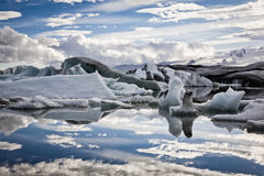 Glacier lagoon reflection. Iceberg reflection in lake Jökulsárlón in Iceland Stock Photo