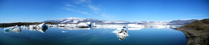 Jökulsárlón ultra wide panorama. Ultra wide panorama of Jökulsárlón glacial lake in southeast Iceland, on the edge of Vatnajökull National Park Stock Photo