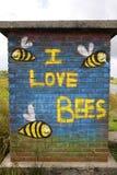J'aime des abeilles murales Image stock