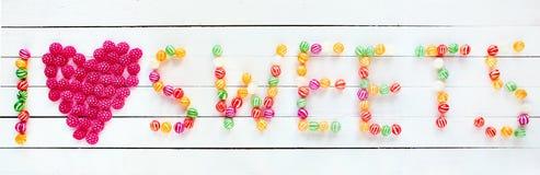 J'aime des bonbons écrits avec des sucreries Images stock