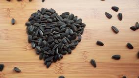 J'aime des graines de tournesol Photographie stock libre de droits