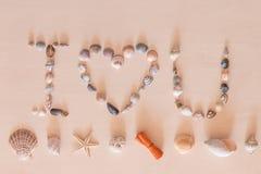 J'aime des mots d'U par la coquille de mer Image stock