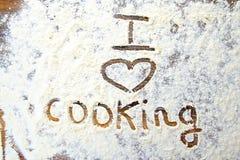 J'aime faire cuire me connecte la farine Photo libre de droits