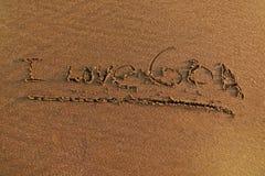 J'aime Goa, fond abstrait de sable Images stock